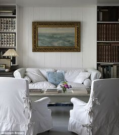 white walls, white slipcovers, books and SEASCAPE! Would look great in the family room Living Room Decor, Living Spaces, Living Rooms, White Rooms, White Walls, White Decor, Sofa Design, Design Design, Interior Design Inspiration