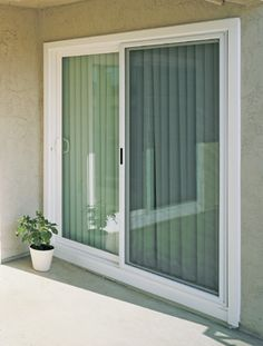 White Sliding Patio Door With SmartTouch® Handle. Featuring Tuscany® Series  Vinyl