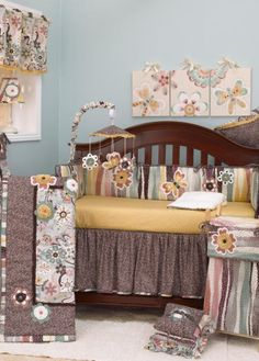Searching for an Aqua colored #CribBedding set? You'll be pleased with this muted color pallet of dancing flowers and chasing butterflies. The ultra feminine retro flower and mosaic Eggplant Penny Lane #BabyBedding will be perfect for your adorable baby girl nursery. $241.99 and #FreeShipping