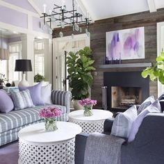 Lovely purples contrast with wood and grays for a rustic-yet-lovely living room.