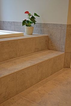 Elegant spa-like bathroom with custom tile work surrounding this drop-in whirlpool tub.