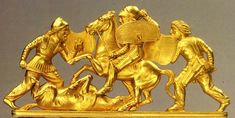 """Battle scene from crest of Scythian golden comb was found in or near the right shoulder/skull of """"king"""" in royal burial mound, 430-390 years BCE. Crest depicts a battle scene resting on 4 crouching lions. Dnieper, barrow, Solokha inlet burial. Excavations NI Veselovskogo 1913. The State Hermitage Museum."""