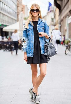 distressed denim jacket, flirty dress and studded sneakers