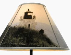 how to make make lampshade with photos to transfer paper  wow, so easy to do  http://www.completely-coastal.com/2013/01/make-lampshade-with-photos-to-fabric-transfer.html