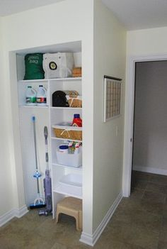 Just the left half, in a cabinet, in the kitchen. This would be ideal to store the mop, broom, dustpan, vacuum, and a couple shelves above for storing a bucket, some cleaning supplies, etc.