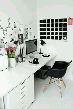Black and white with a pop of colorful flowers. Calm and naturally scented place to work