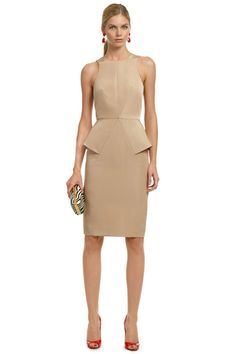 Look incredibly chic in this nude, geometric sheath by Cushnie et Ochs for that cocktail party of the year. A fashion forward style that will have everyone in awe. Add a pop of color by going with the Kenneth Jay Lane's Ruby Red Drops and an animal print clutch like the Diane von Furstenberg Handbag's Zebra Tonda Pony Clutch.