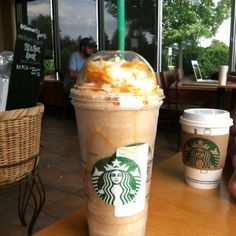 Caramel Frappachino and a random person in the Background.(: