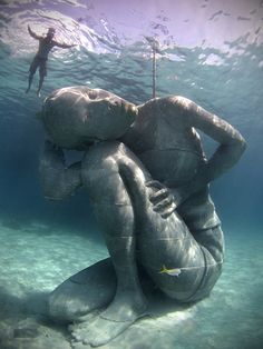 Jason deCaires Taylor recently installed Ocean Atlas, a huge underwater sculpture depicting young local girl holding up the ceiling of the ocean, off the coast of Nassua in the Bahamas. Constructed using sustainable pH neutral materials, the colossal piece is meant to serve as an artificial reef for marine life.   http://www.underwatersculpture.com/