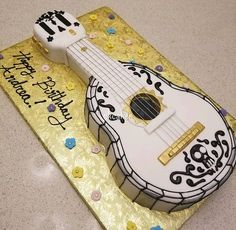 When Life Gets Me Down, I Play My Guitar - Disney's Coco. . . . . . . . #disney #disneyland #disneymovie #coco #guitar #guitarcake #cake #themecake #cakes #birthday #music #dayofthedead #disneyinspired #art #chefofinstagram #chefoninstagram #gold #pixar #baker #bakery #fondantcake #fondant #royalicing #skull