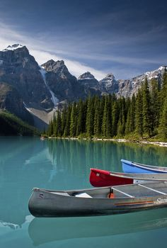 Beautiful high mountain lake with canoes in Banff National Park, Alberta, Canada Ways To Travel, Places To Travel, Places To Visit, Travel Tips, Canada Images, Banff National Park, Canada Travel, Rocky Mountains, Dream Vacations