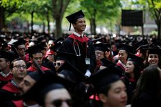 USA-EDUCATION/ Graduating Medical School student Sumir Pandit stands to receive his degree during the 365th Commencement Exercises at Harvard University in Cambridge, Massachusetts. REUTERS/Brian Snyder