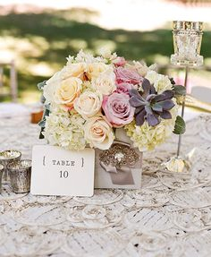 peach rose and hydrangea wedding centerpiece. This page also has info on seating guests in tables of 4-6 people instead of 8-10