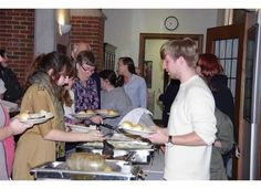Student, faculty and guests line up for the buffet at the Robert Burns Dinner, January 28, 2013.