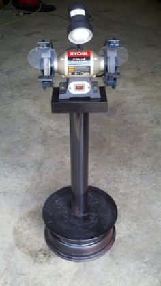 """""""My fire Chief asked me if I could build him a grinder stand. This thing turned out so good, I think I am going to build myself one. The base is an old rim filled with concrete. It weighs about 100 pounds."""