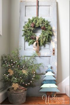 Tree in a galvanized bucket, chippy old door with a wreath, and a Christmas tree made from architectural salvaged wood. in the meantime used your door as a decoration! Merry Little Christmas, Christmas Love, Country Christmas, Winter Christmas, All Things Christmas, Christmas Wreaths, Christmas Crafts, Christmas Ideas, Christmas Vignette