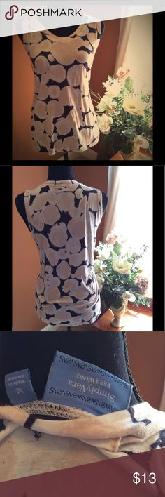 🌷Vera Wang Top🌷 Simple but elegant Vera Wang top. Colors are black, white, & a cross b/n light pink & cream. The design is multi shaped circles. Material is soft & light to medium weight.This is a reposh.It doesn't fit.I can say the top is in excellent condition w/ no problems.However not knowing how it looked when bought I can't gauge colors accurately.Whether they are soft/light colors or a very slight fading I cannot tell.But it is still beautiful.I got to wear w/nice black shorts,look…