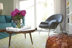 Love the coffee table, rug, and gray chair!