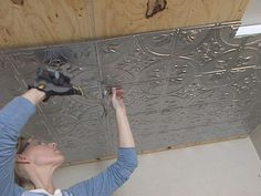 How to Install Tin Ceiling Tiles : How-To : DIY Network/bay back porch ceiling. Diy Network, Kitchen Ceiling, Stamped Tin Ceiling, Stamped Tin, Tin Tiles, Ceiling Decor, Home Repair, Ceiling Tiles, Home Diy
