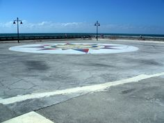 The White Street Pier on Key West- Giant Compass Rose is painted on the pier. Some people call the White Street Pier, 'The Unfinished Road to Cuba.'