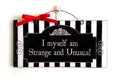 Lydia quote. Beetlejuice sign. I myself am strange and unusual. Notice the black & white stripes? Gotta have Tim Burton quotes printed out & hung on the walls. Nice work, Bone Daddy! Halloween with Tim Burton ~~ Halloween Party Decorations & Ideas