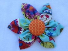 aqua paisley fabric flower by YeauxYeauxBows on Etsy, $8.00