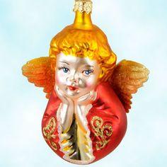 This Christopher Radko Sweet Dreams Angel ornament gazes from afar