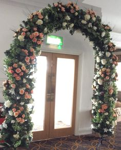 Artificial Arch in Ivory and peach silk flowers by Cathey's flowers