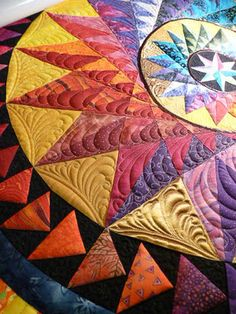 Paper piecing, wonderful feather quilting that enhances the piecing.