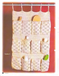 Crochet organizer - with thicker top loops, bigger pockets, and a stiff thread, this could be remade for shoes.