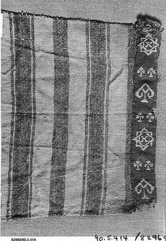 Fragment of a Sleeve Object Name: Fragment Date: 5th–6th century Geography: Egypt Culture: Coptic Medium: Wool, linen; plain weave, tapestry weave Dimensions: 8 7/8 in. high 9 5/16 in. wide (22.5 cm high 23.7 cm wide) Classification: Textiles Credit Line: Gift of George F. Baker, 1890 Accession Number: 90.5.414