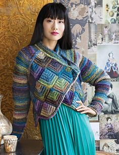 The rich dark blue, forest green, and violet of Ito colroway #21 provides a fascinating medium for gather-stitch sleeves and a showstopping body of mitered squares.