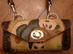 Breya's completed panda purse. My third leather working project.