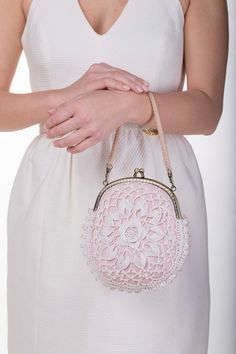 This beautiful purse is done in beautifully intricate Irish Crochet Lace. Hand crochet with glass seed beads and cotton crochet thread. The