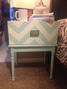 Nightstand Makeover:  Added box to top with one open side and painted chevron design/Total cost $11.00