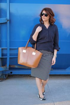Navy top, striped pencil skirt, neutral tote