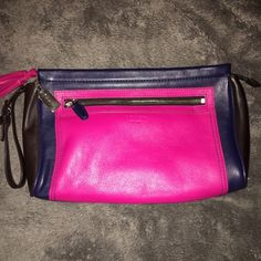 Coach Colorblock Clutch This is a Coach Legacy fuschia, navy and brown clutch with a removable wrist strap.  Has an outside zip compartment on the front with one on the inside.  Tassel with Coach hang tag on the zipper.  Great clutch for spring and summer. Coach Bags Clutches & Wristlets