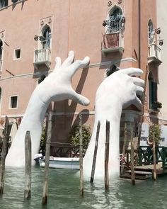 Support: Monumental Hands Rise from the Water in Venice to Highlight Climate Change   Colossal