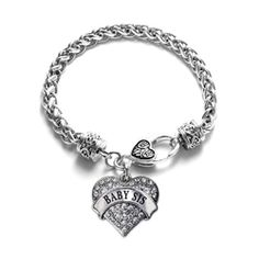Show your love and support for that special someone in style!  The one inch charm is decorated with 2.0 carats of pave set CZ accents and hangs from a stylish 7 1/1 inch white metal bracelet. The chain linked bracelet features a sterling silver finish and toggle style clasp. Lookout for the matching necklace, earrings, and memory charm! This item is proudly made in the U.S.A!