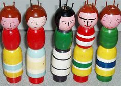 Group of Vintage Tricotins D Simple painted facial features on these vintage spool knitters - the French name is tricotin