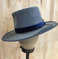 distressed heathered blue telespcope crown fur felt hat with blue velvet ribbon and custom feather pick by hatWRKS on Etsy