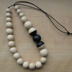 Simply beautiful - Necklace with Hand Painted Wooden Beads & Leather - Eco-friendly. €32.00, via Etsy.