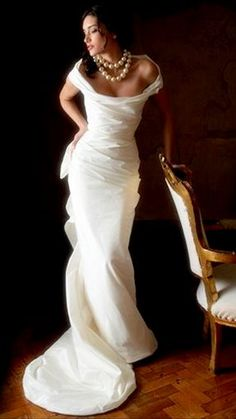 Beautifully fitted, off-shoulder wedding dress