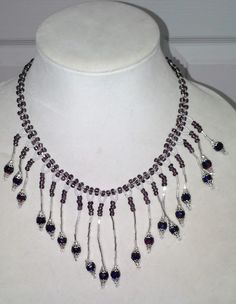 Waterfall necklace in plums, silver, white, deep blue and garnet beads by sassybeadedjewelry. Explore more products on http://sassybeadedjewelry.etsy.com