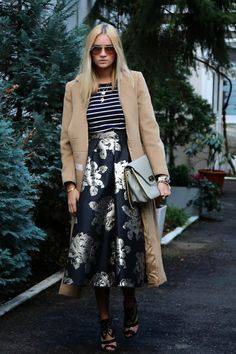 Camel coat, striped pullover, midi skirt, shoes, bag.