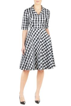 A shawl collar frames the V-neckline of our cotton ikat check dress, nipped in at the waist with self-piped trim and flared out to a full skirt.