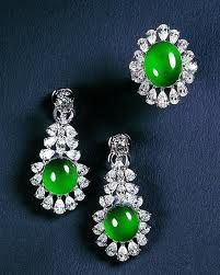 Earrings and ring of imperial green jadeite and diamonds
