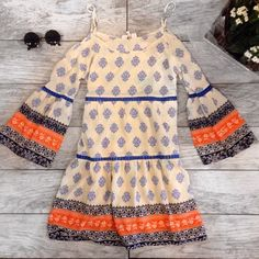 Cold Shoulder printed Dress Boarder printed bell sleeve tiered dress featuring crochet detailing throughout. Non sheer. Fully lined. Woven. Light weight. FABRIC : 100%RAYON Dresses Long Sleeve