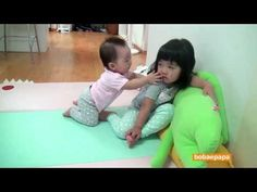 """Yerin Park and her little sister, Yeseo Park, are two cute kiddies from South Korea. Here, Yerin's watching her favourite TV show, and Yeseo's trying to get her attention. I love how patient Yerin's being with her little sister, but the whole time, her expression makes me think that she's going, """"Just let me watch!"""""""