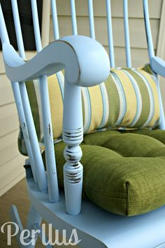 Rocking chair, refinished with a bright paint color and a new seat cushion and pillow. I'm going to keep this idea tucked away in case I come across an old rocking chair. :)